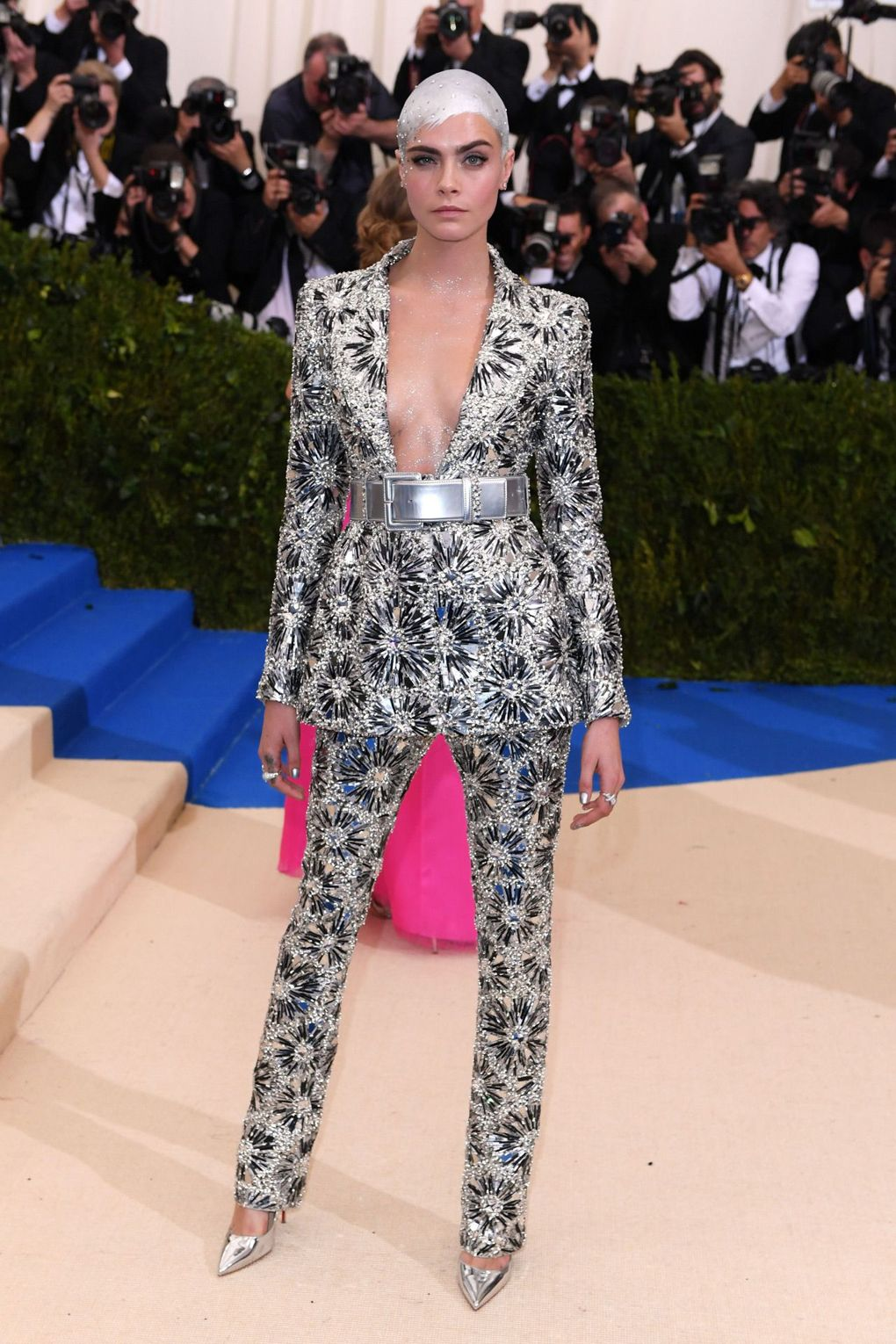 Cara Delevingne in a silver Chanel suit.